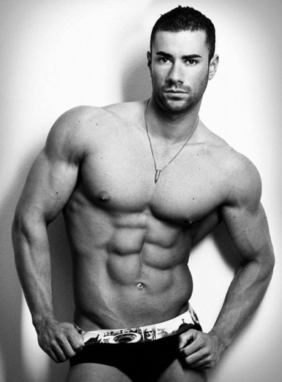 This hottie is Alexandre Carneiro. Is that an eight-pack?
